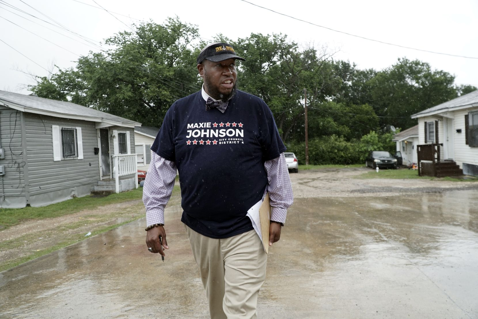 Maxie Johnson canvassed for voters in the Cedar Crest neighborhood in Dallas on May 20, 2021.