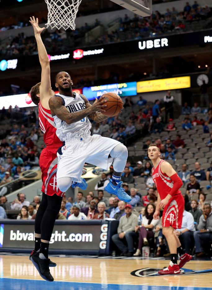 DALLAS, TX - DECEMBER 27:  Pierre Jackson #55 of the Dallas Mavericks drives to the basket against the Houston Rockets in the second half at American Airlines Center on December 27, 2016 in Dallas, Texas. NOTE TO USER: User expressly acknowledges and agrees that, by downloading and or using this photograph, User is consenting to the terms and conditions of the Getty Images License Agreement.  (Photo by Tom Pennington/Getty Images)