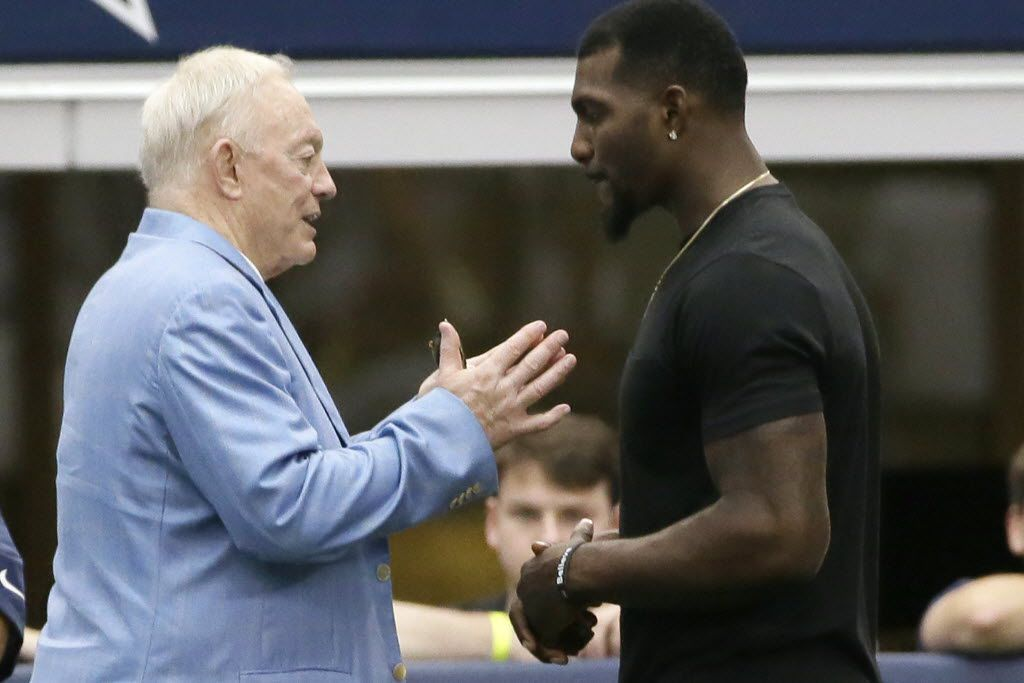 FILE - Dez Bryant (right) listens to Cowboys owner Jerry Jones on the sidelines during minicamp practice at the team's stadium in Arlington on Thursday, June 18, 2015. (AP Photo/LM Otero)