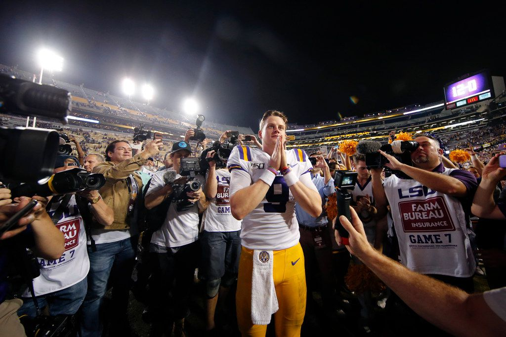 LSU quarterback Joe Burrow (9) gestures thanks to the student section after playing his last game in Tiger Stadium, an NCAA college football matchup against Texas A&M in Baton Rouge, La., Saturday, Nov. 30, 2019. LSU won 50-7. (AP Photo/Gerald Herbert)