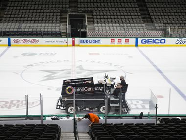 Crews clean and prepare to cover the Dallas Stars ice after all NHL were suspended due to coronavirus on Thursday, March 12, 2020 at American Airlines Center in Dallas.