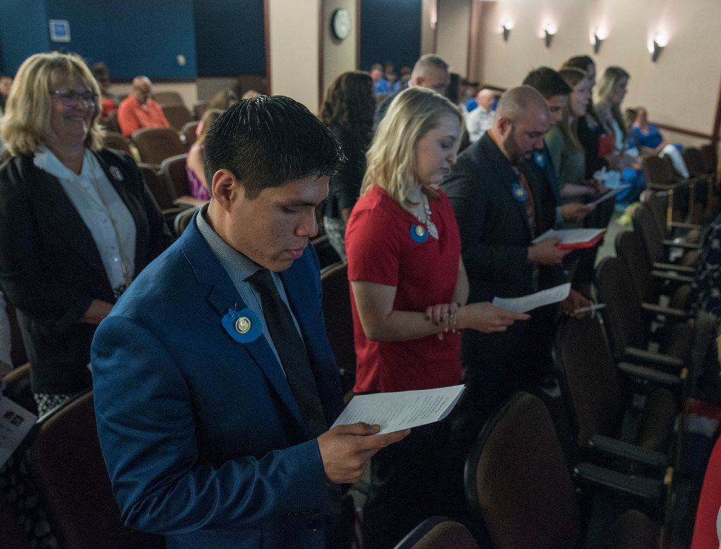 Nursing graduates Rudy Diaz (foreground), Kelsi Johnson and Travis Barbosa recited the Nightingale Pledge during a pinning ceremony at Medical City Children's Hospital in Dallas in May. The nurses graduated from Medical City's 2-Step Nursing Pathway program.  (Rex C. Curry/Special Contributor)