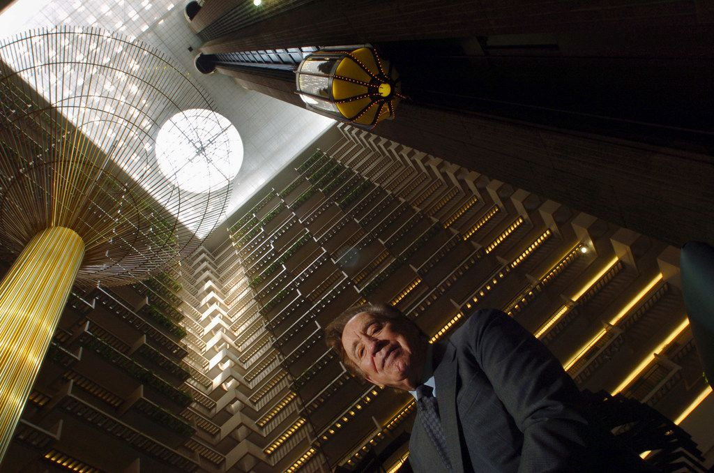 FILE Ã' John Portman in the lobby of the Hyatt Regency hotel, which he designed, in Atlanta, May 31, 2006. Portman, the architect and developer who revolutionized hotel designs with soaring futuristic atriums, built commercial towers that revitalized the downtowns of decaying postwar American cities and transformed Asian skylines from Shanghai to Mumbai, died Dec. 29, 2017, at the age of 93.