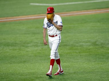 Rangers relief pitcher Jimmy Herget (64) yells into his glove after finishing out the top of the seventh inning against the Oakland Athletics at Globe Life Field in Arlington on Tuesday, Aug. 25, 2020.