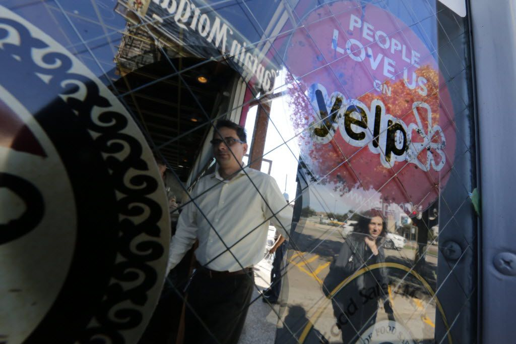 The well-known Yelp sticker on the door of the Velvet Taco on North Henderson Avenue in Dallas.