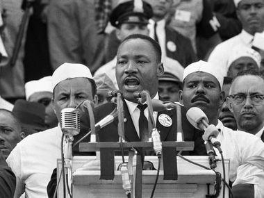 """In this Aug. 28, 1963 photo, Dr. Martin Luther King Jr., head of the Southern Christian Leadership Conference, addresses marchers during his """"I Have a Dream"""" speech at the Lincoln Memorial in Washington. (AP Photo/File)"""