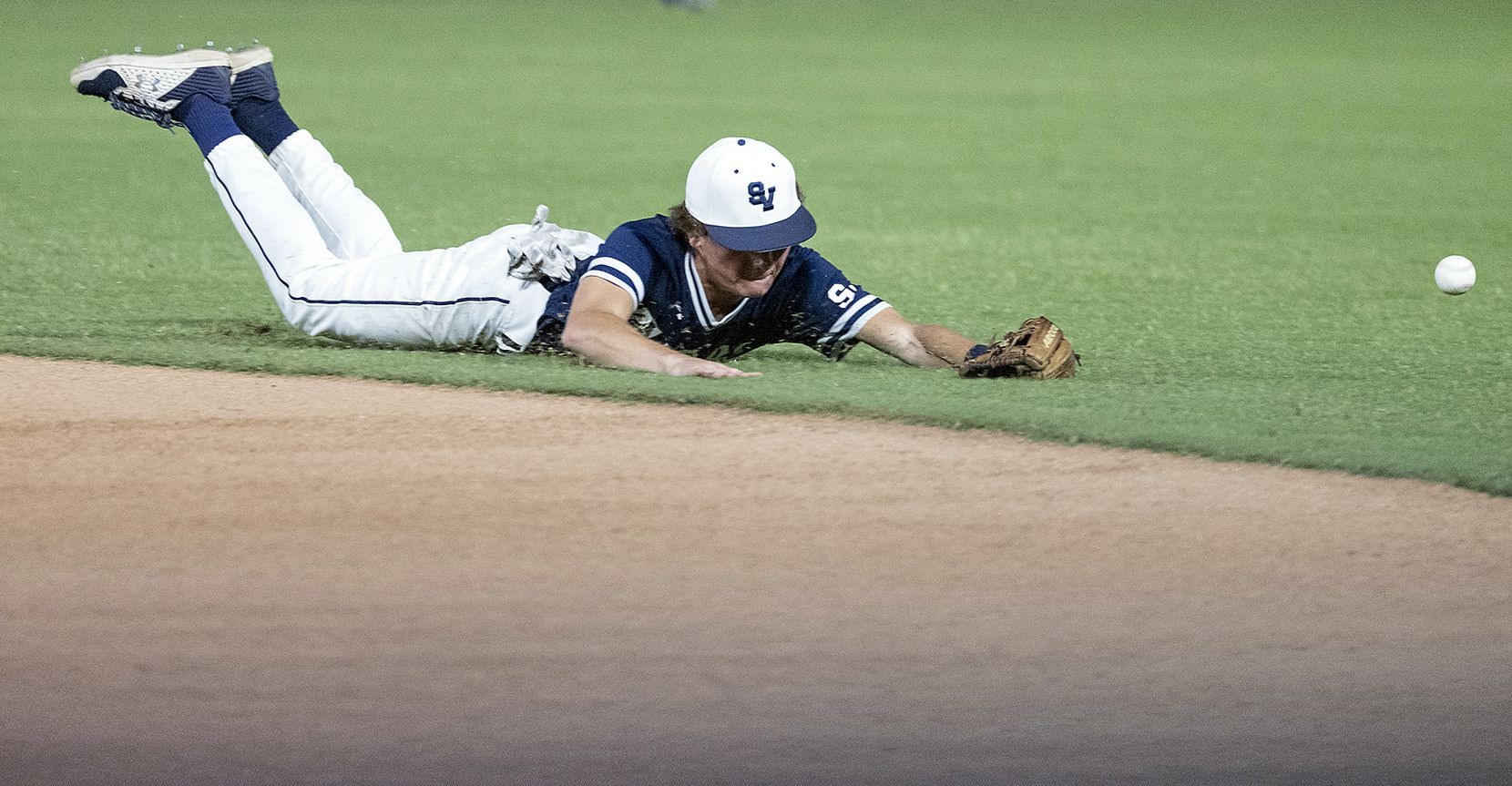 A ground ball hit by Rockwell-Heath Caleb Hoover, (7), gets past Comal Smithson Valley Cameron Hodges, (12), during the third inning of the 2021 UIL 6A state baseball semifinals held, Friday, June 11, 2021, in Round Rock, Texas.    (Rodolfo Gonzalez/Special Contributor)