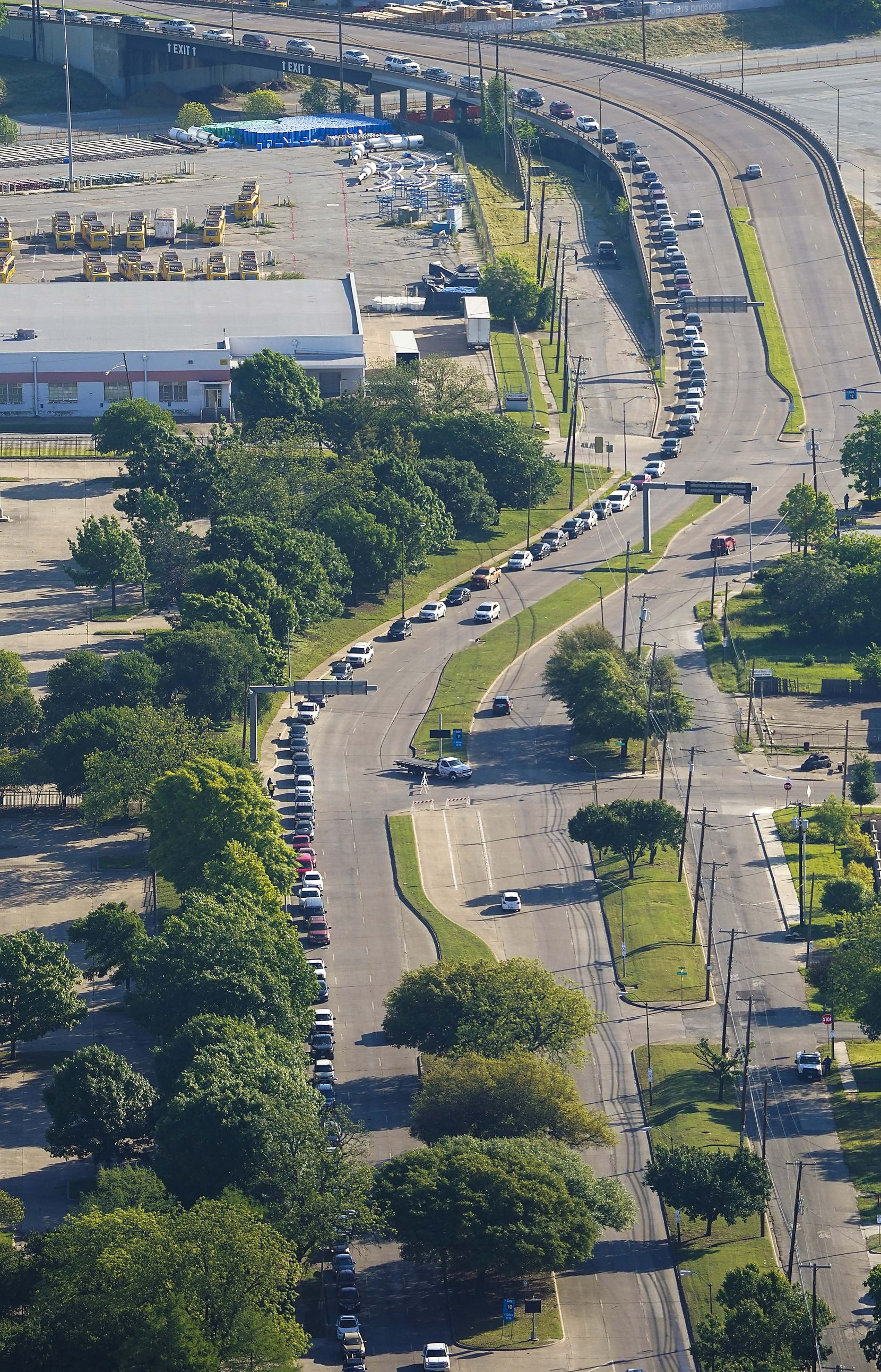 Traffic at Fair Park stretched nearly 1.8 miles at one point Thursday as people waited to receive food from the North Texas Food Bank and partner agencies.