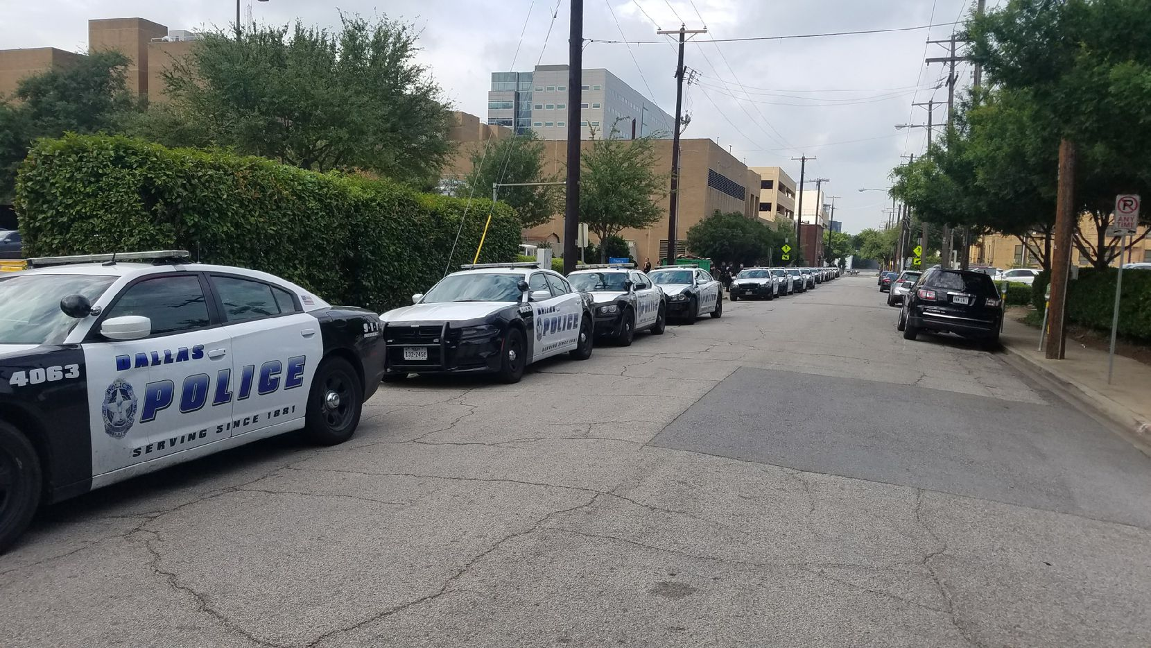 Squad cars waited outside Baylor University Medical Center's rehab facility to escort Officer Crystal Almeida to her home in The Colony.