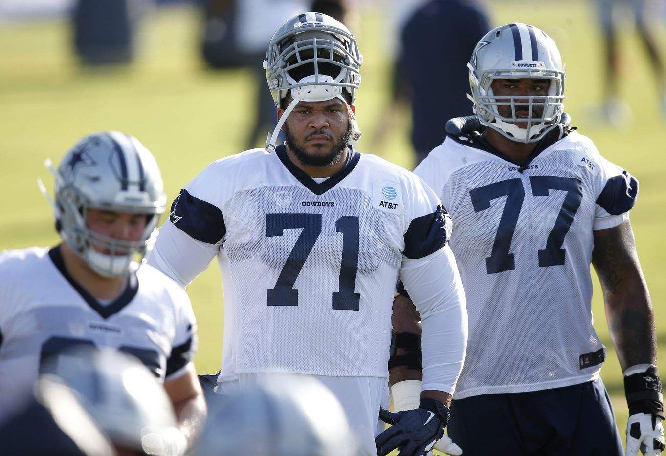 Dallas Cowboys offensive tackle La'el Collins (71) and Dallas Cowboys offensive tackle Tyron Smith (77) watch a drill in progress during the first day of training camp at Dallas Cowboys headquarters at The Star in Frisco, Texas on Friday, August 14, 2020. (Vernon Bryant/The Dallas Morning News)