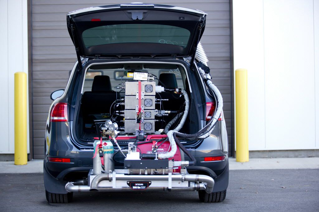 A 2014 Volkswagen Touareg TDI, a diesel model, equipped with a portable emissions testing system by the EPA's National Vehicle and Fuel Emissions Laboratory in Ann Arbor, Mich. Spurred by the Volkswagen scandal, in recent weeks regulators in the U.S. and Canada abruptly began testing car emissions on the road and in real-world conditions, rather than traditional laboratories, looking specifically for cheaters. (File Photo/The New York Times)