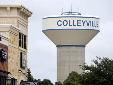 A Colleyville water tower is pictured near a shopping center in Colleyville, Texas, Tuesday, June 23, 2020.