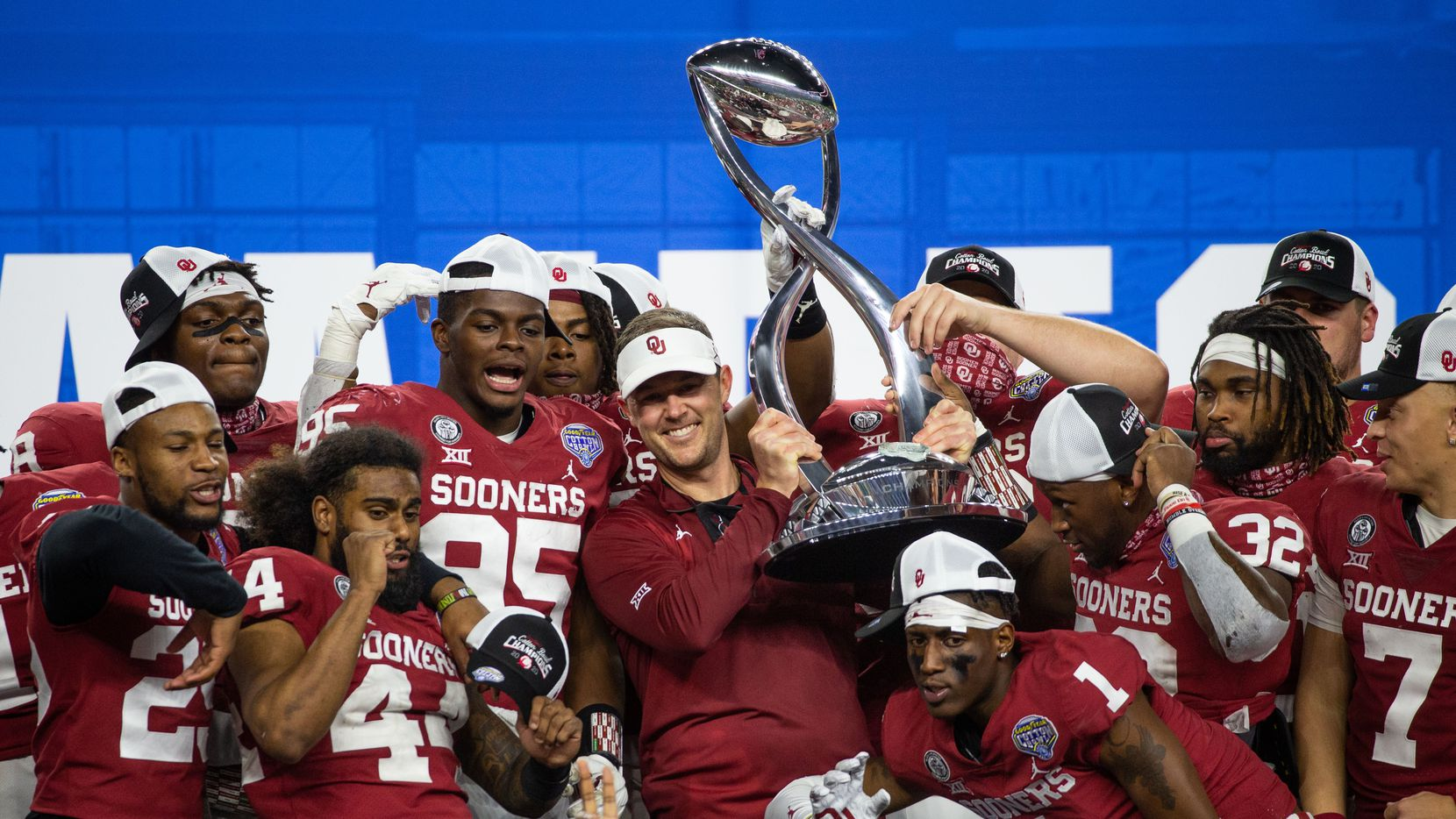 Oklahoma Sooners head coach Lincoln Riley holds up the Cotton Bowl champions' trophy and celebrates with his team during the post-game ceremony following the Goodyear Cotton Bowl Classic football game on Thursday, Dec. 30, 2020.