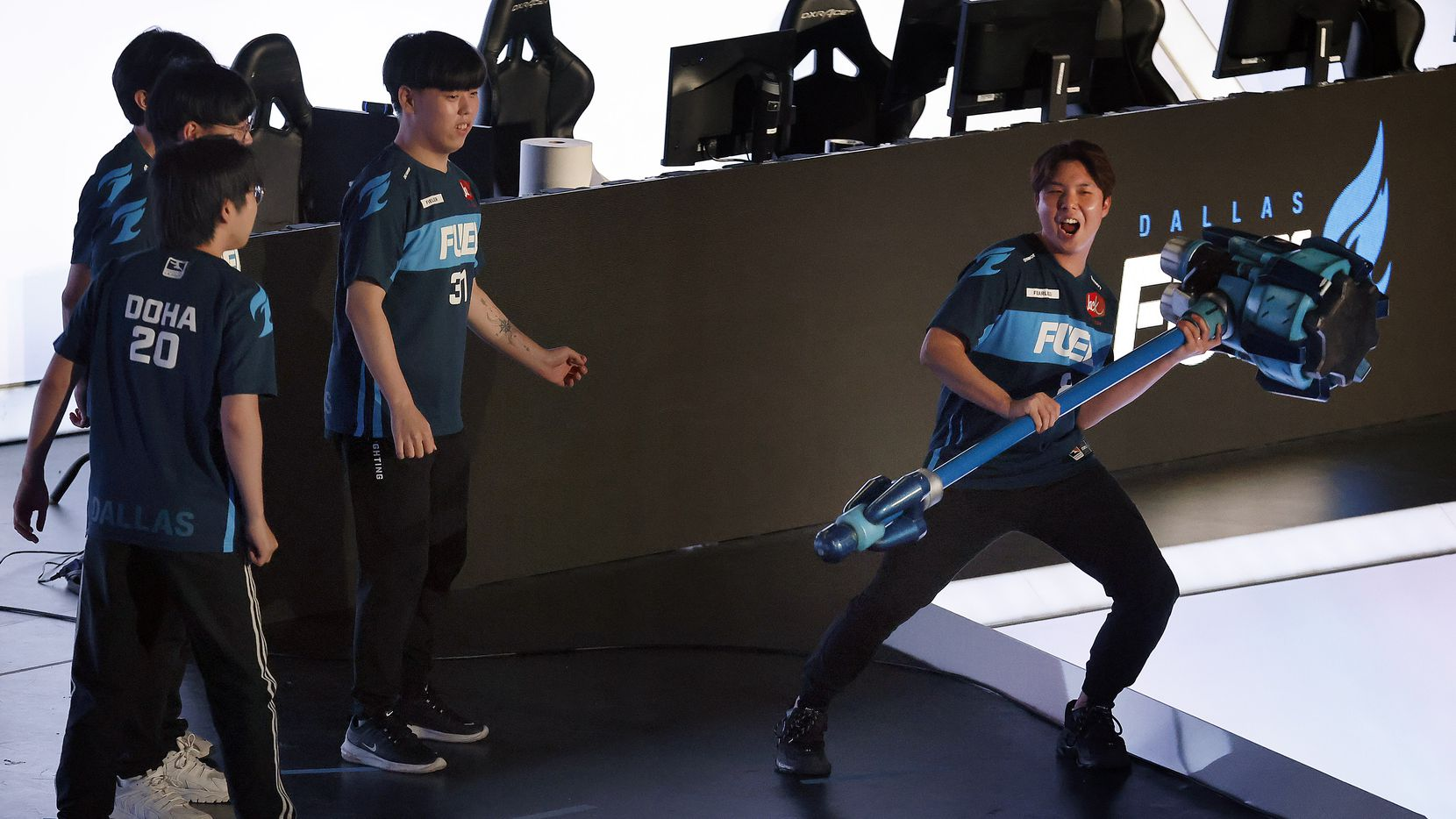 Dallas Fuel player Fearless (right) yells before slamming Reinhardt's hammer, knocking over his teammates during their Overwatch League introductions at Esports Stadium Arlington Friday, July 9, 2021. Dallas Fuel defeated the Houston Outlaws in The Battle for Texas, 3-0. It was the first in-person live competition for fans in over a year. Houston competed from their hometown.