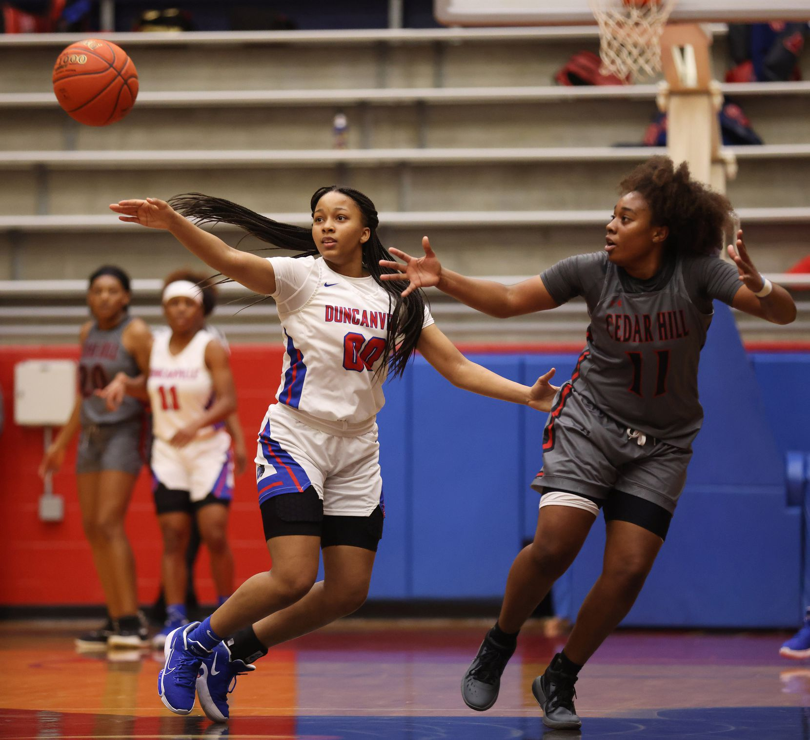 Duncanville's Hope LeMelle (00) defends as a pass makes its way towards Cedar Hill's Portia Adams (11) during the first half of play at Sandra Meadows Arena at Duncanville High School on Tuesday, January 12, 2021 in Dallas.