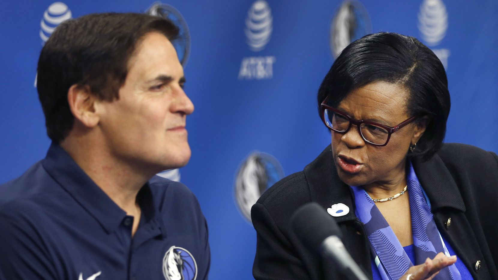 February 26, 2018: Dallas Mavericks CEO Cynthia Marshall advises owner Mark Cuban on an answer during a press conference at American Airlines Center in Dallas. Marshall was hired by the Mavericks to help clean up the organization after a sexual harassment scandal in the front office.