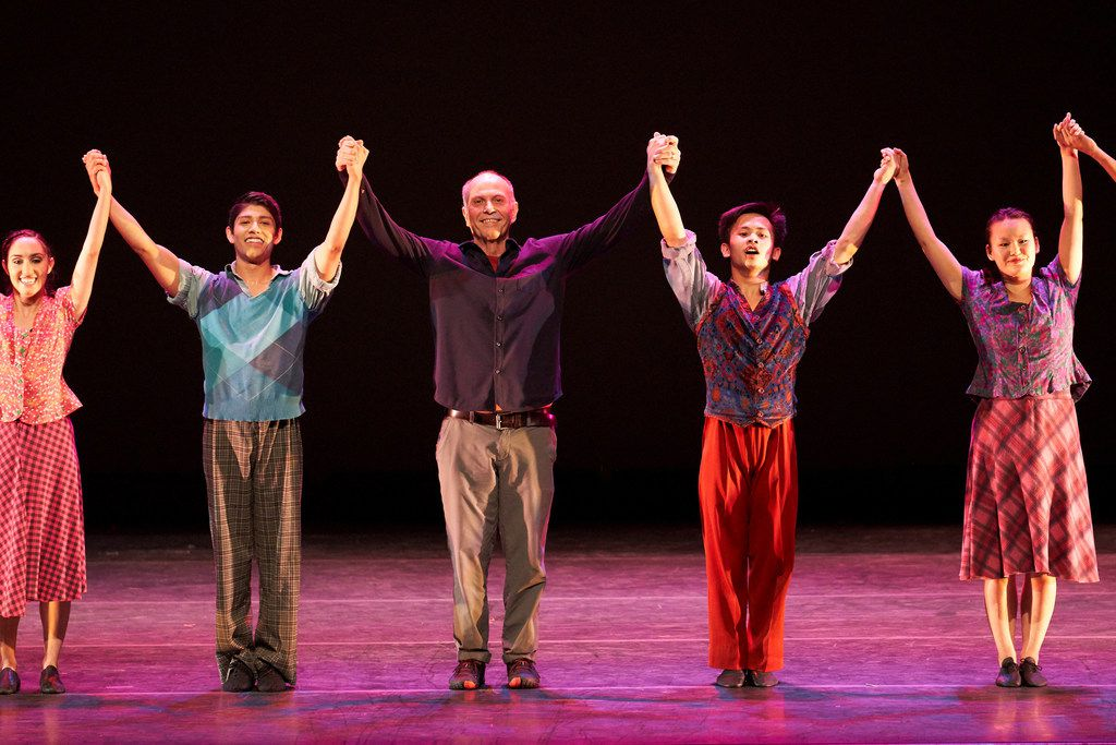 """Retiring SMU dance professor Danny Buraczeski (center) takes his bows at the end of the SMU Spring Dance Concert, which was dedicated to his choreography. The show included """"Swing Concerto,"""" choreographed by Buraczeski."""