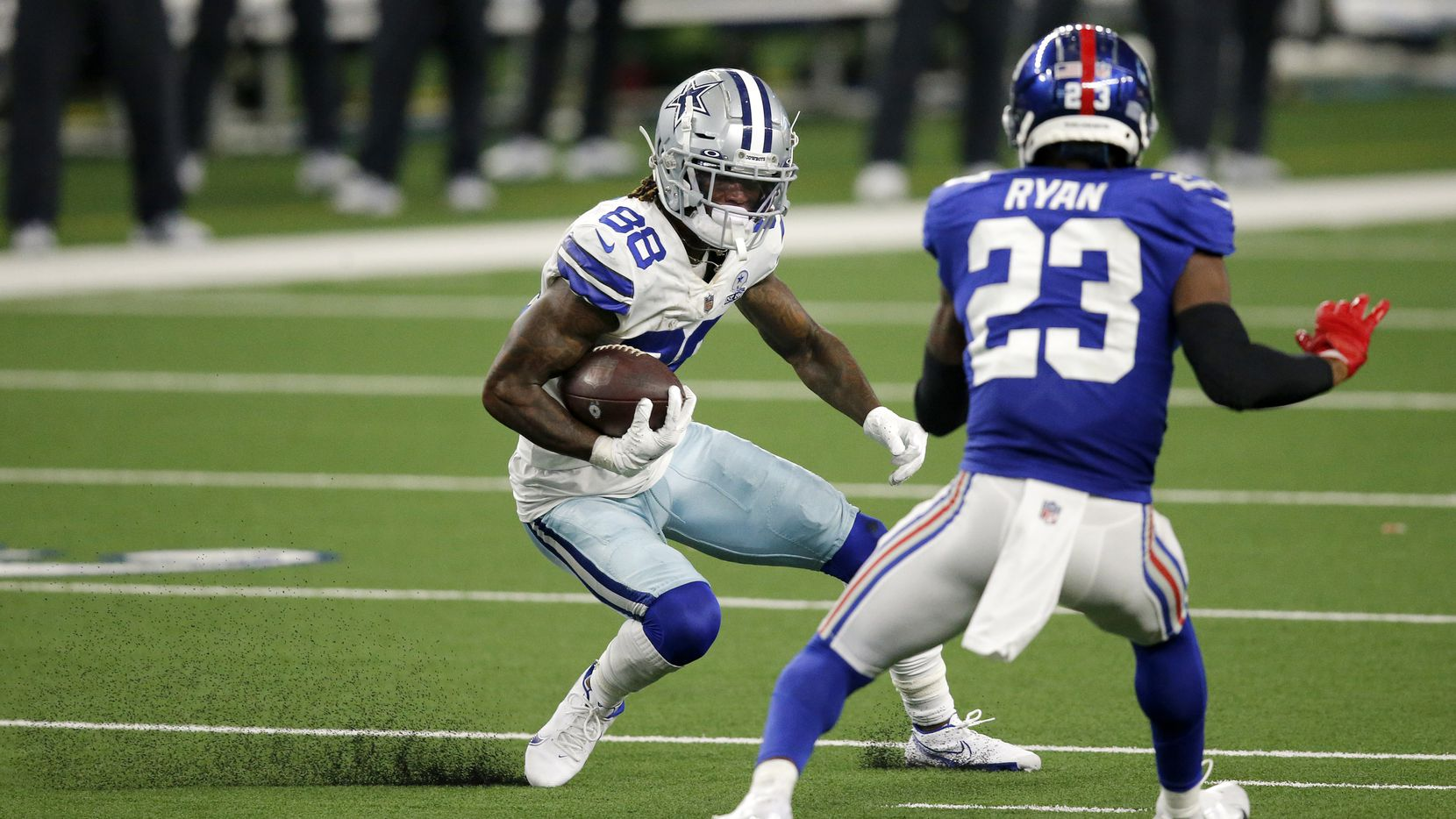 Cowboys wide receiver CeeDee Lamb (88) puts on the brakes to avoid Giants defensive back Logan Ryan (23) during the fourth quarter of a game on Sunday, Oct. 11, 2020, at AT&T Stadium in Arlington.