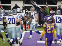 Cowboys tight end Dalton Schultz (center) celebrates with teammates after catching a 2-yard touchdown pass during the second half of a game against the Vikings on Sunday, Nov. 22, 2020, in Minneapolis. (AP Photo/Bruce Kluckhohn)