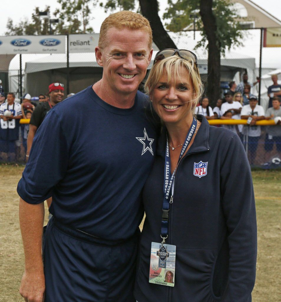 Dallas Cowboys head coach Jason Garrett and his wife, Brill, pose after their afternoon practice in Oxnard, CA, on Aug 9, 2014.  (Michael Ainsworth/The Dallas Morning News)
