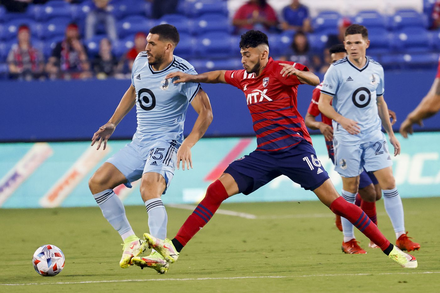 FC Dallas forward Ricardo Pepi (16) goes for the ball against Minnesota United defender Michael Boxall (15) during the first half of a game on Saturday, Oct. 2, 2021, at Toyota Stadium in Frisco. (Juan Figueroa/The Dallas Morning News)