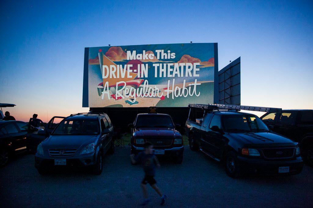 Movie previews are shown at the Stars & Stripes theater in New Braunfels. (Julysa Sosa /San Antonio Express-News via AP)