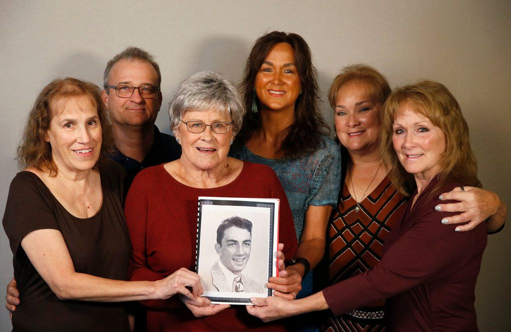 Alicia Crawford Burrough, Rodney Burrough, Nancy Morgan Dice, Colleen Crawford, Christi Crawford, and Teri Crawford Moore pose as they hold a photo of Marine Corps  Pfc. Grady J. Crawford in Dallas on Friday, September 27, 2019. Grady Crawford, 21, of Dallas, was killed in the Korean War during the famous battle of the Chosin Reservoir on Dec. 1, 1950. His body was missing until this year when his remains were identified.
