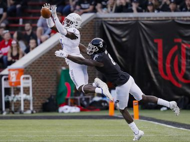 FILE - Tulsa cornerback Reggie Robinson II (9) breaks up a pass intended for Cincinnati wide receiver Malick Mbodj (8) during the second half of a game on Saturday, Oct. 19, 2019, in Cincinnati. (AP Photo/John Minchillo)