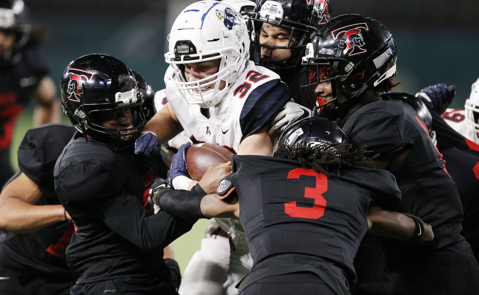 Allen senior wide receiver Carson McKay (32) battles for yardage against Euless Trinity defenders during the first half of a high school Class 6A Division I Region I semifinal football game at Globe Life Park in Arlington, Saturday, December 26, 2020. (Brandon Wade/Special Contributor)