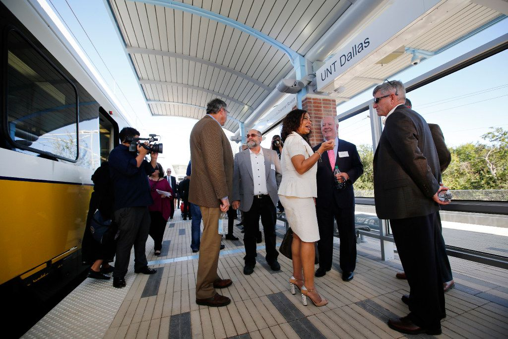 Officials mingle at the UNT Dallas Station in southeast Oak Cliff.
