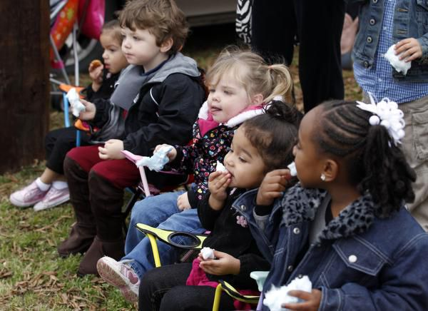 Texas is trying to prop up day care centers as parents lose work because of the novel coronavirus. Steps include help for existing centers, such as Kids Stop Day Care in Lewisville, whose children are shown at a 2012 parade.