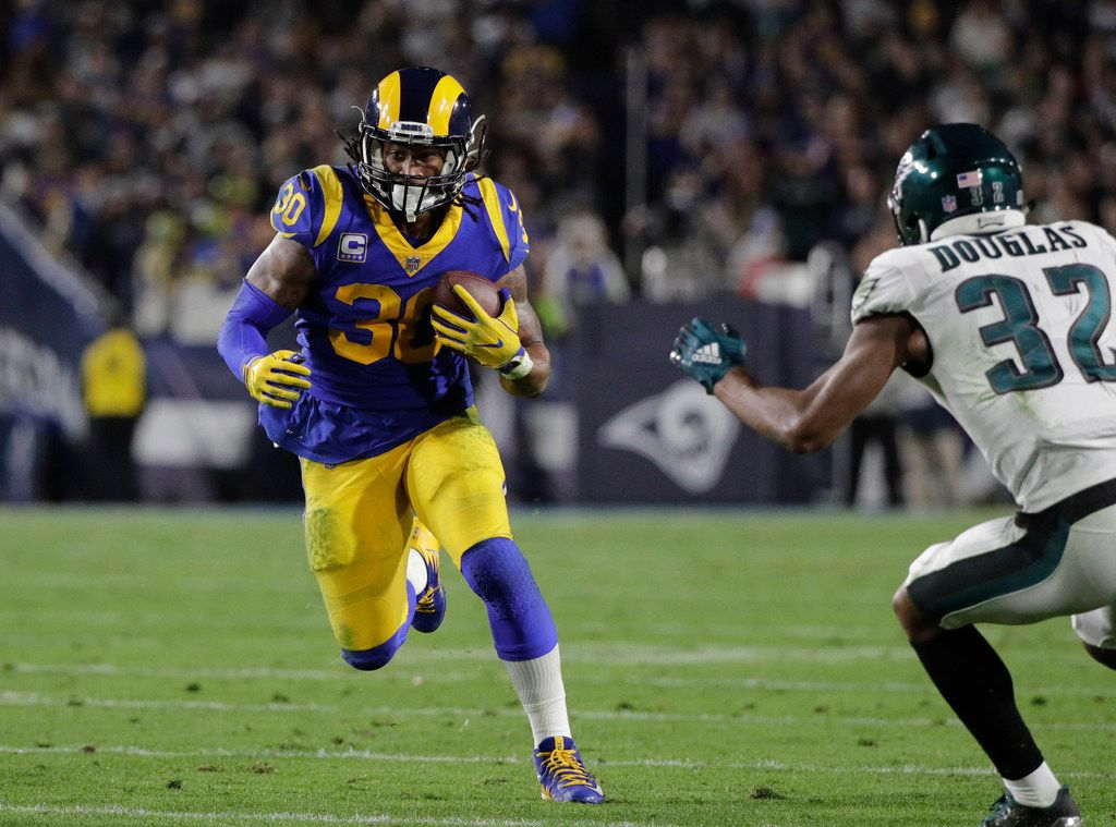 File-This photo taken Dec. 16, 2018, shows Los Angeles Rams' Todd Gurley carrying the ball during an NFL football game against the Philadelphia Eagles in Los Angeles. Gurley has been ruled out of Los Angeles' regular-season finale Sunday, Dec. 30, 2018, against San Francisco with a knee injury. Gurley will miss the Rams' final two games of the regular season due to the injury, but McVay says he isn't concerned about the star running back's availability for the playoffs. (AP Photo/Jae C. Hong, File)