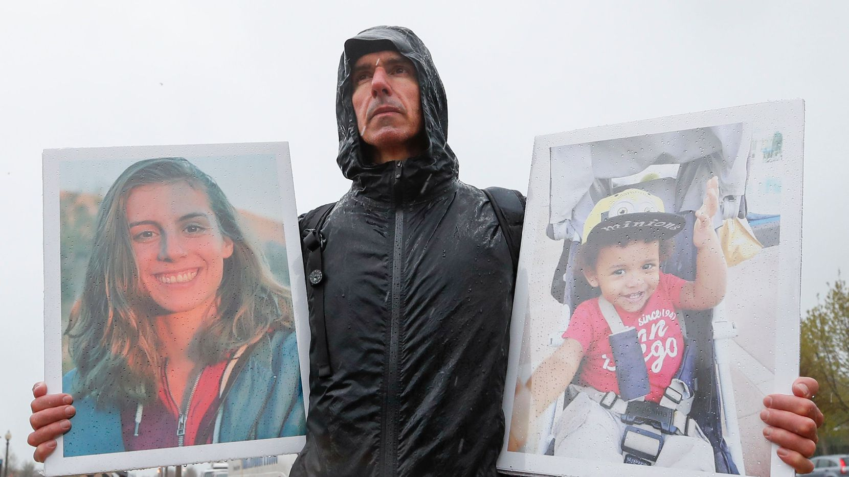 Tarek Milleron holds the photographs of victims in the Ethiopian Airlines Flight 302 Boeing plane crash during a protest outside Boeing's annual shareholders meeting at the Field Museum on April 29, 2019 in Chicago, Illinois.