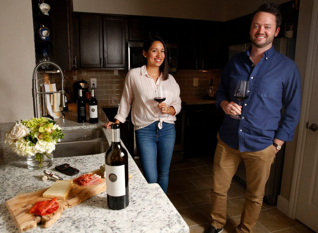 Michael Kennedy, founder of Component Wine Company, poses for a photograph with his wife Rachel Kennedy at their home in Dallas on March 27, 2017. (Rose Baca/The Dallas Morning News)