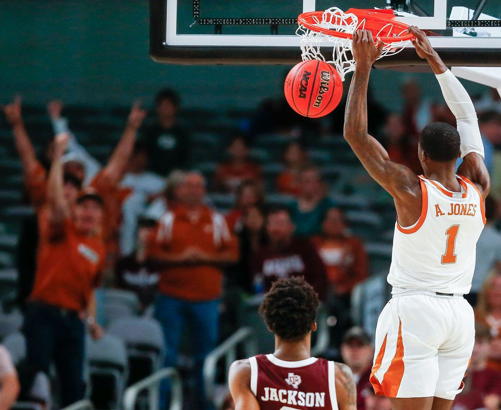 Texas Longhorns guard Andrew Jones dunked over Texas A&M Aggies guard Quenton Jackson in the Lone Star Showdown in Fort Worth in December 2019.
