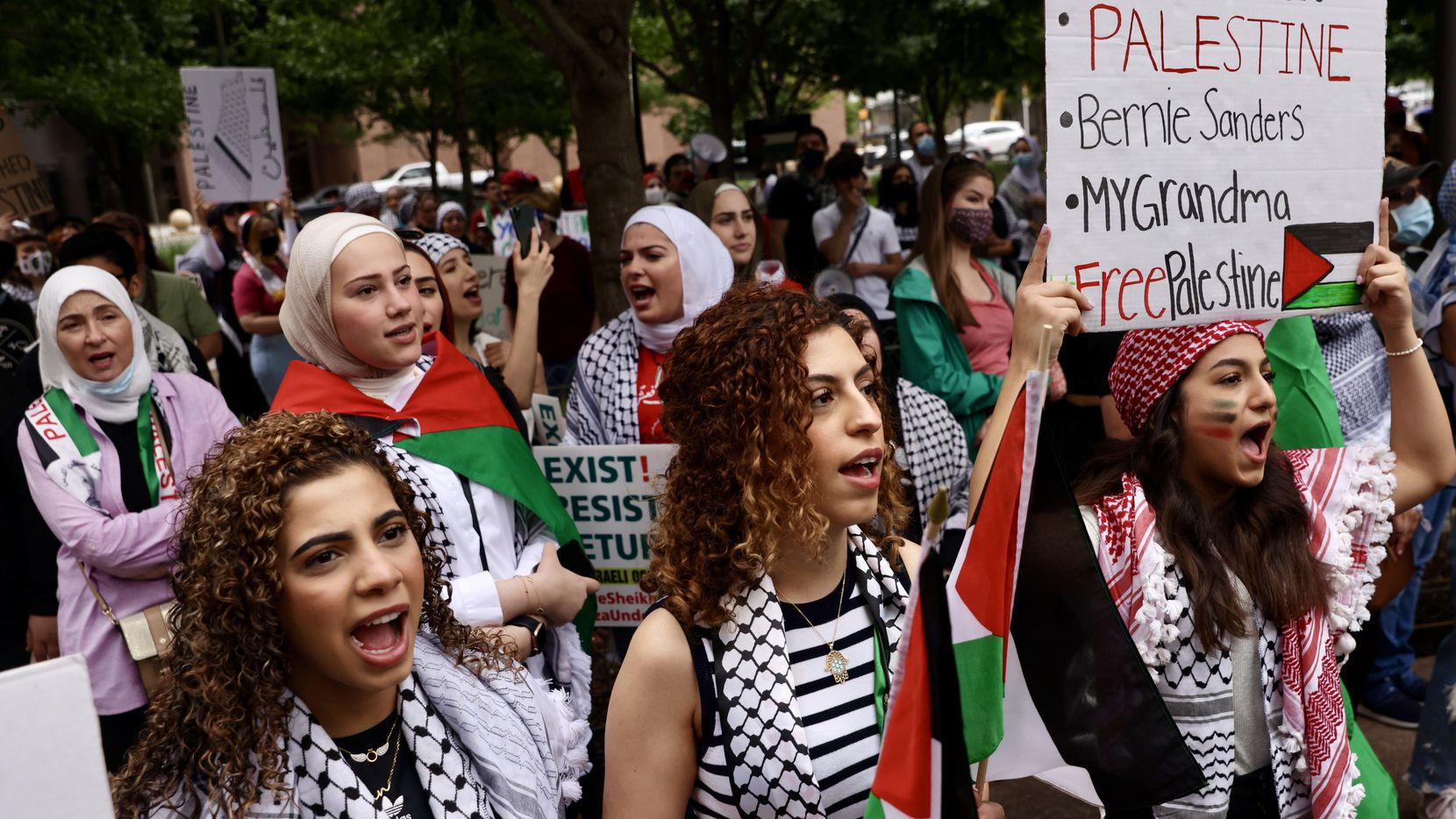 Sisters Iman (from left), Jumana, and Soondos Aboukarr were part of the pro-Palestine crowd at Sunday afternoon's demonstration in downtown Dallas.