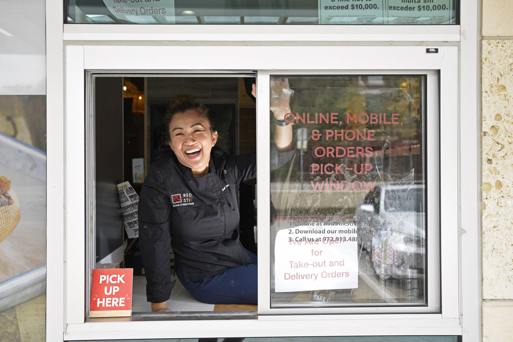 Chef Uno Immanivong of Red Stix Asian Street Food in Dallas at their take-out window