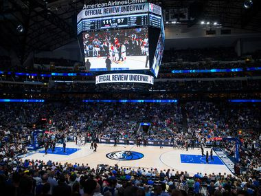 FILE - A mostly full arena in the fourth quarter of a game between Mavericks and Denver Nuggets on Wednesday, March 11, 2020, at American Airlines Center in Dallas.