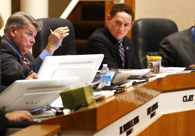 Dallas County Commissioner Mike Cantrell (left) is one of two commissioners accusing County Judge Clay Jenkins of improperly inserting himself into a contract bid process.