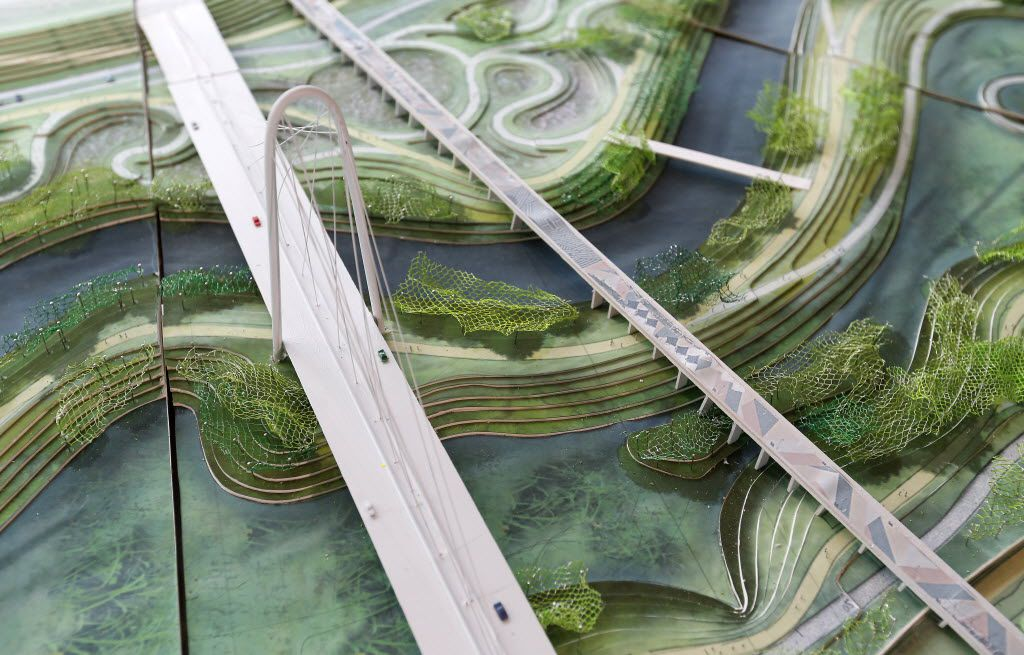 The Margaret Hunt Bridge (left) and the Continental Avenue Pedestrian Bridge are seen (looking as if east-to-west) on a model of the Trinity River Park plan at the City Club in Dallas, Thursday, May 19, 2016. One element of the conceptual plan is to change the path of the Trinity River from a straight channel to a meandering one. (Jae S. Lee/The Dallas Morning News)