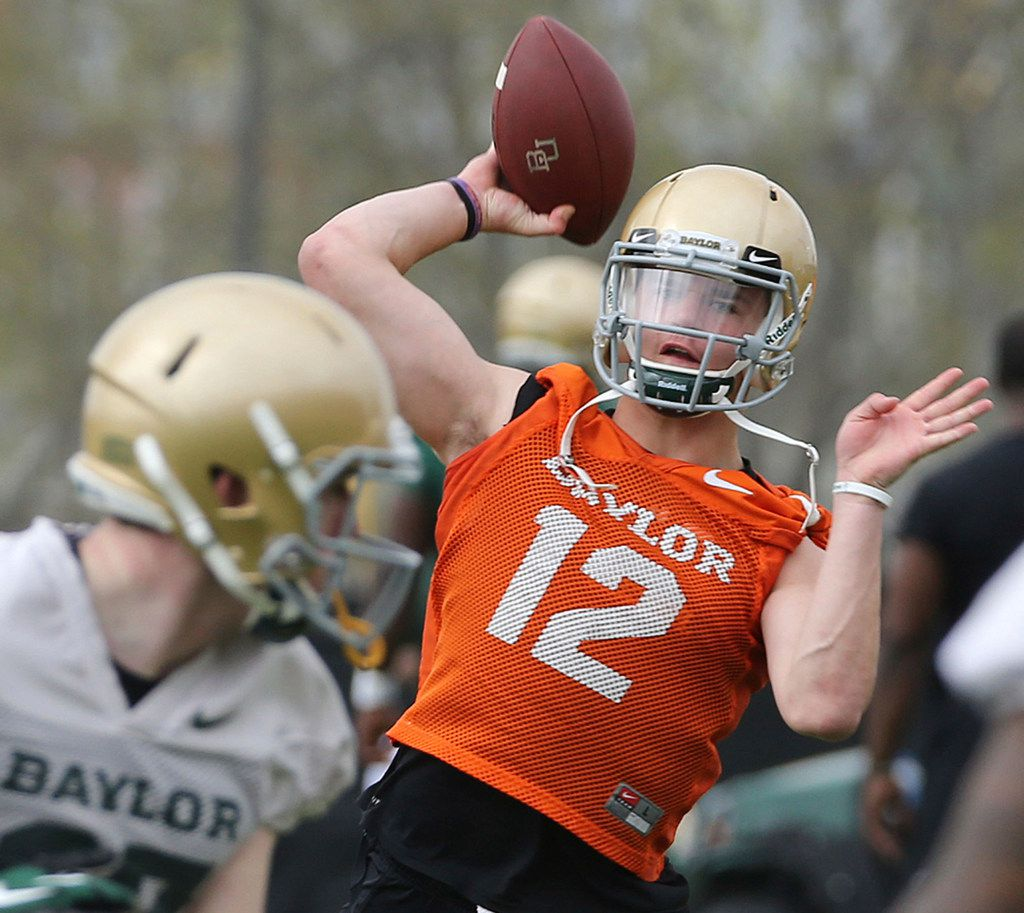 Baylor quarterbacks Charlie Brewer throws during the team's first day of spring NCAA college football practice, Thursday, March 15, 2018, in Waco, Texas. (Jerry Larson/Waco Tribune-Herald via AP)