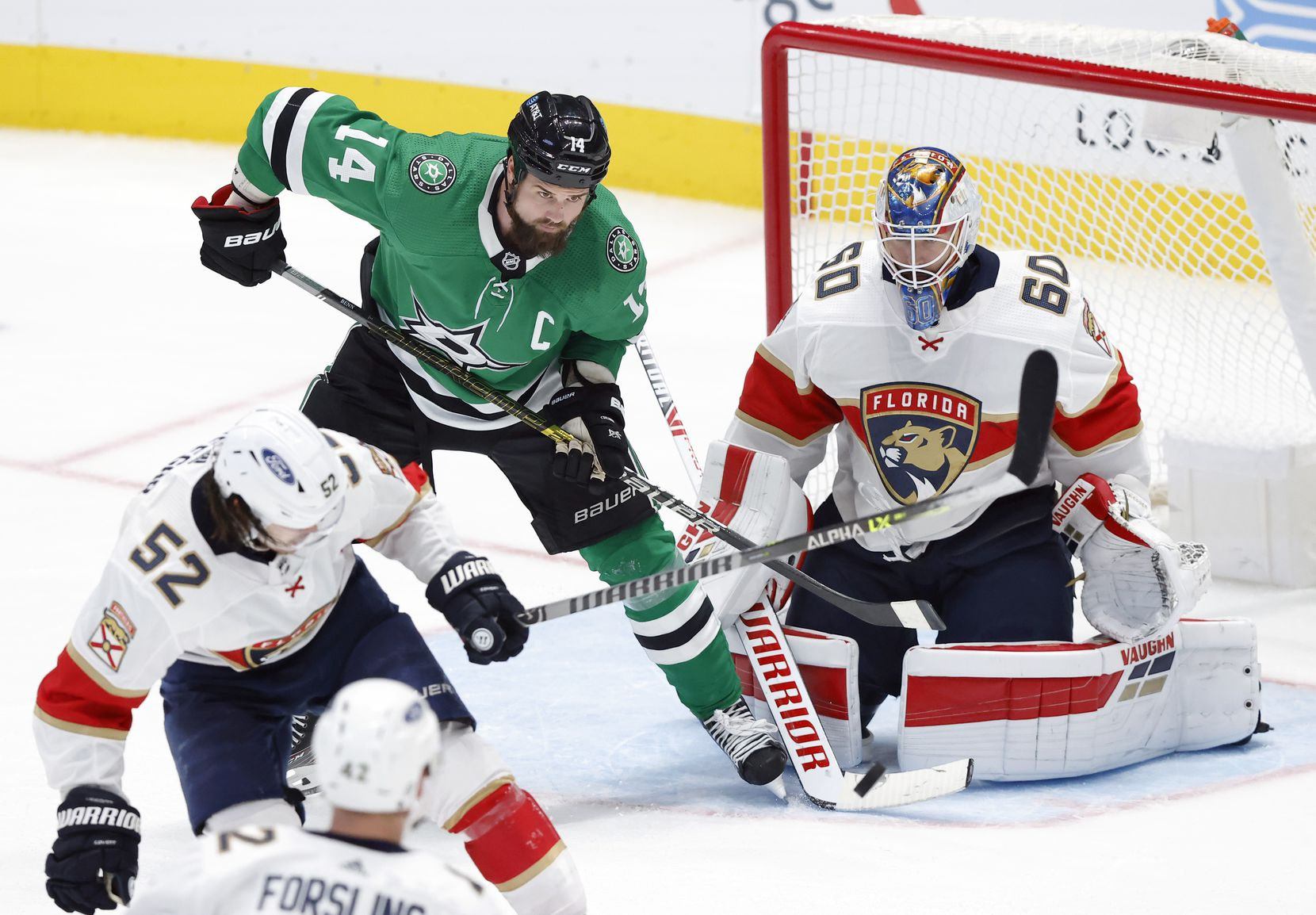 Dallas Stars left wing Jamie Benn (14) is in position to deflect the puck on Florida Panthers goaltender Chris Driedger (60) put can't get a stick on it during the third period at the American Airlines Center in Dallas, Tuesday, April 13, 2021. (Tom Fox/The Dallas Morning News)