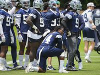 Dallas Cowboys defensive end Randy Gregory (94) takes a knee between drills during a minicamp practice at The Star on Tuesday, June 8, 2021, in Frisco.