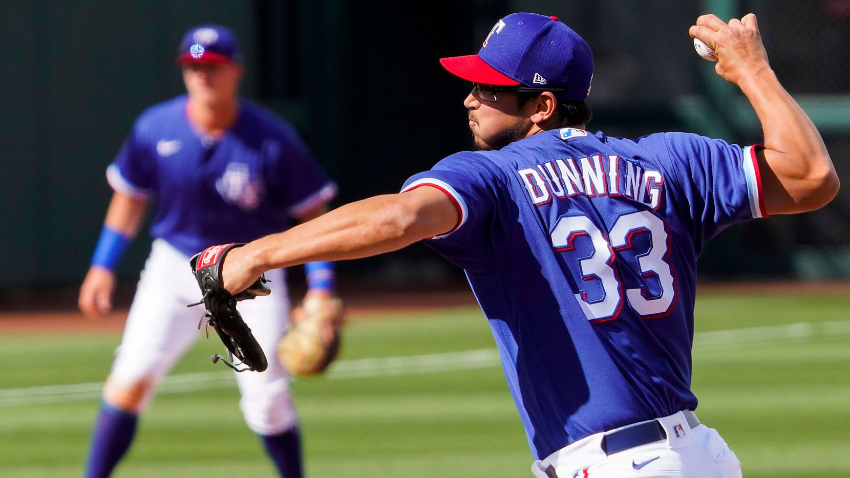 Texas Rangers pitcher Dane Dunning delivers during the seventh inning of a spring training game against the Los Angeles Dodgers at Surprise Stadium on Sunday, March 7, 2021, in Surprise, Ariz. (Smiley N. Pool/The Dallas Morning News)