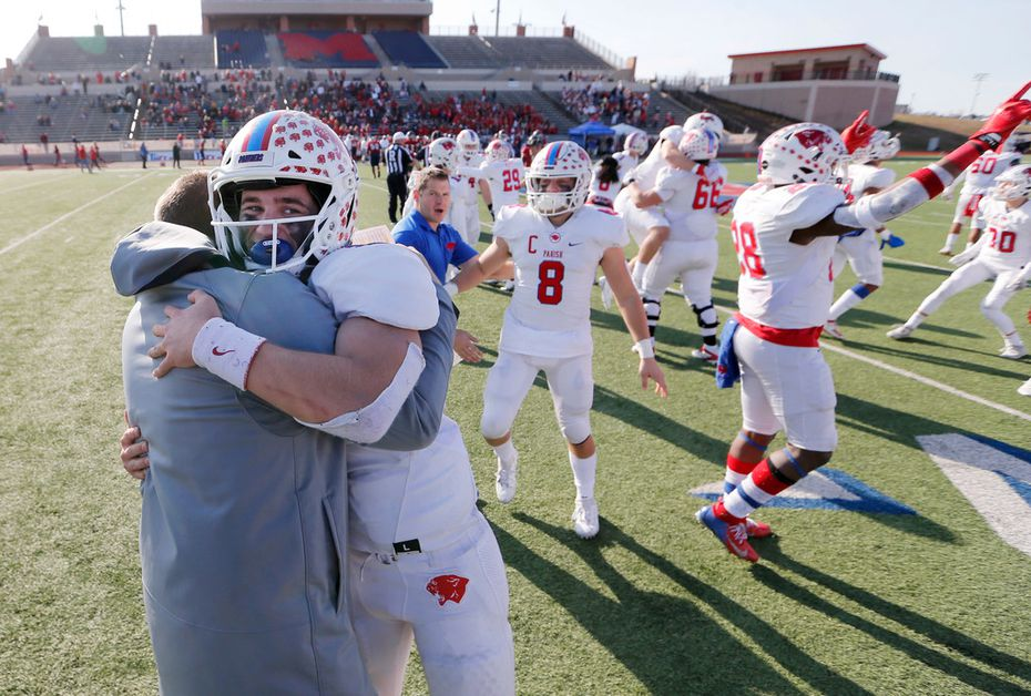 Parish Episcopal's Preston Stone (2) hugs head coach Daniel Novakov in celebration after defeating Plano John Paul II 42-14 in the TAPPS Division I State Championship game at Waco Midway's Panther Stadium in Hewitt, Texas on Friday, December 6, 2019.