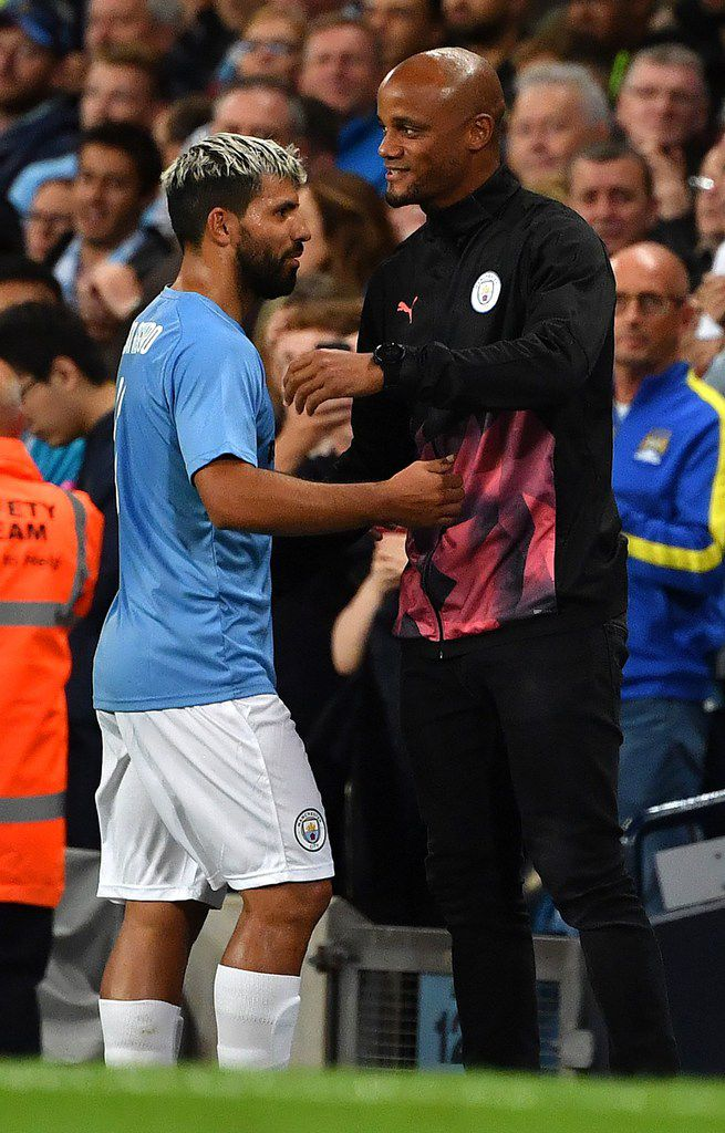 Manchester City Legend's forward Sergio Aguero (L) is congratulated by Former Manchester City defender, and Anderlecht's player manager Vincent Kompany as he leaves the pitch after being substituted off during the Vincent Kompany testimonial football match between the Manchester City Legends and the Premier League All-stars XI at the Etihad Stadium in Manchester, northwest England, on September 11, 2019. (Photo by Paul ELLIS / AFP)PAUL ELLIS/AFP/Getty Images