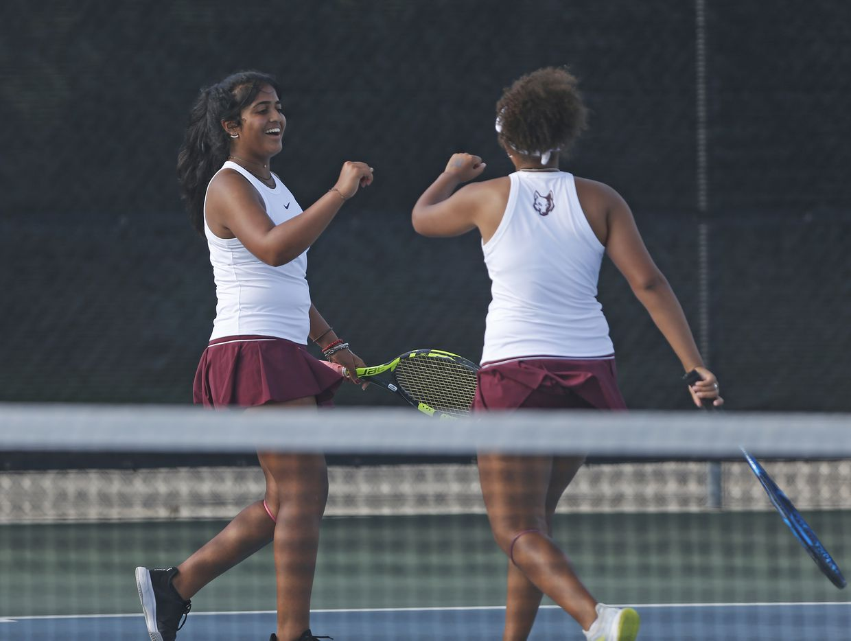 Frisco Heritage's Saundarya Vedula (left) and Tamiya Lintz high five each other after a point in the 5A girls doubles match at the UIL State Tennis finals at Northside Tennis on Friday, May 21, 2021.