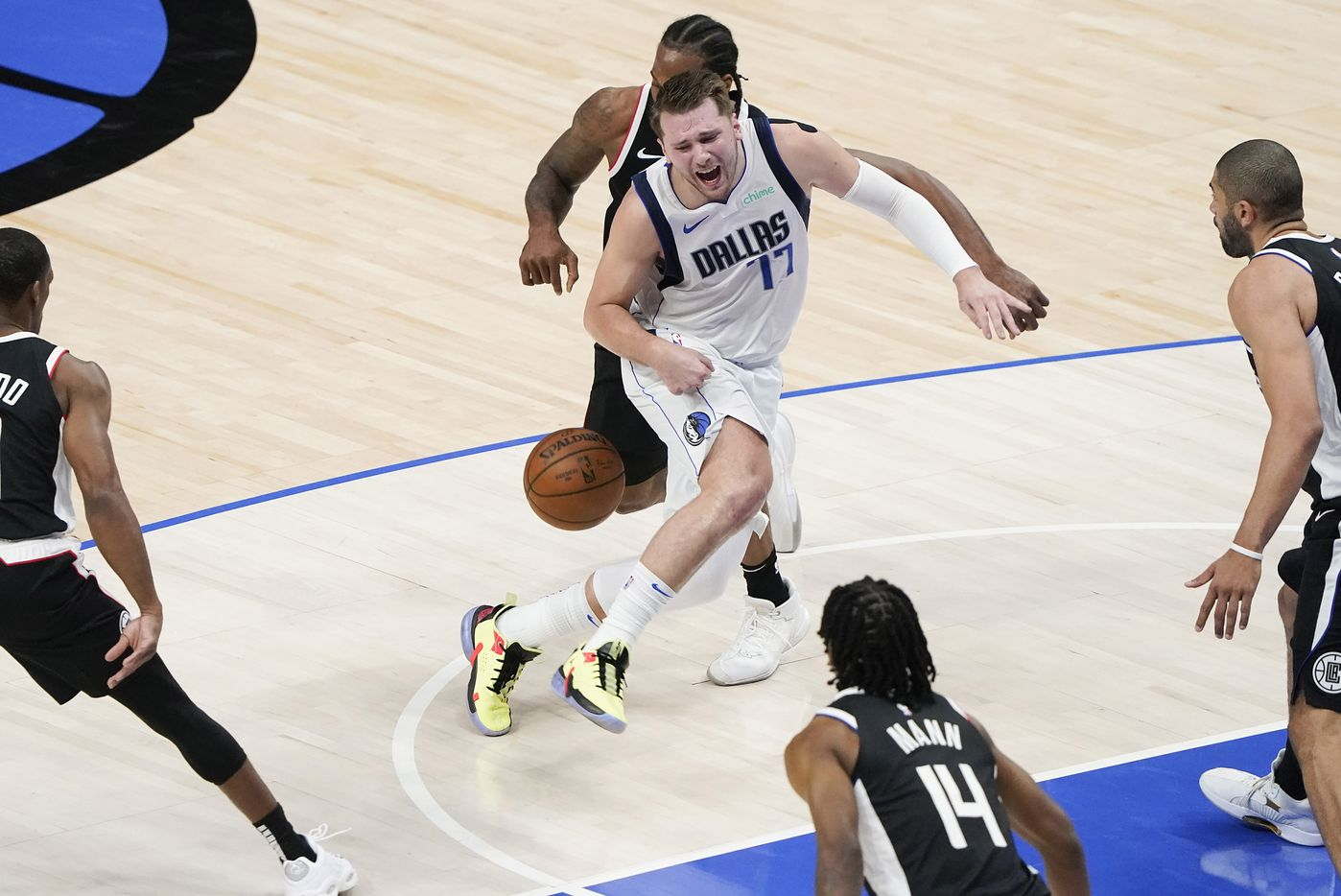 Dallas Mavericks guard Luka Doncic (77) has the ball knocked away by LA Clippers forward Kawhi Leonard (2) during the second quarter of an NBA playoff basketball game at American Airlines Center on Sunday, May 30, 2021, in Dallas.