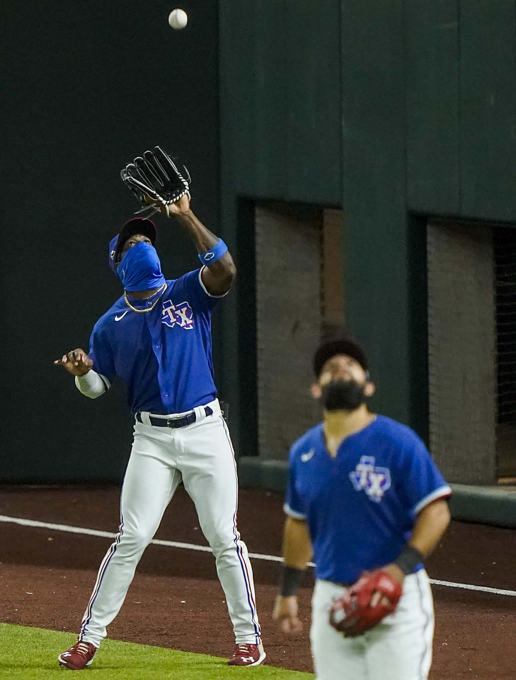 Texas Rangers outfielder Adolis Garcia makes a catch on a fly ball off the bat of Colorado Rockies first baseman Daniel Murphy during the sixth inning of an exhibition game at Globe Life Field on Tuesday, July 21, 2020.