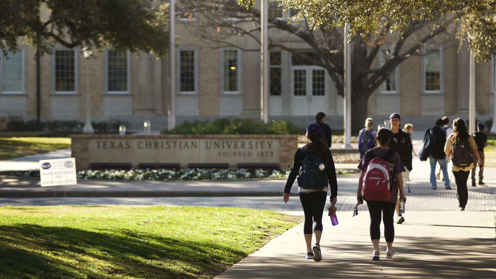 Students at Texas Christian University walk across University Boulevard on campus. A case of mumps was confirmed at the college in September 2018.